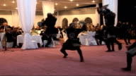 INT * * Music head over following shots SOT * * Dancers performing at birthday party reception for Kadyrov SOT Table laid with ornate platter of food...