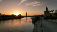 guadalquivir river timelapse with torre pelli puerta del oro y expo 92 sunset day to night timelapse