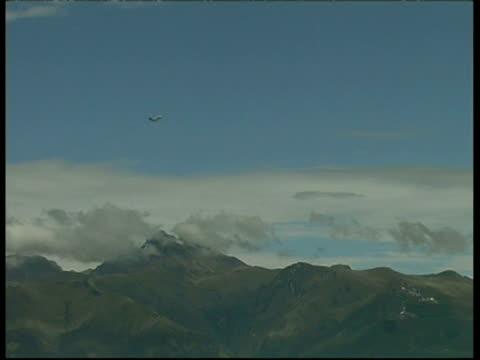 Guagua Pichincha Volcano, plane rising through sky, smoke, Ecuador
