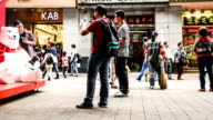 Guangzhou,China-Nov 29,2014: People are attracted by the polar bear model sitting on the Shopping street in Guangzhou, China