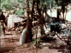Guerilla soldiers at makeshift forest camp 1970s