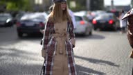 A guest wears a beret a tartan trench coat outside Chanel during Paris Fashion Week Womenswear Spring/Summer 2018 on October 3 2017 in Paris France