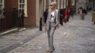 A guest wears a blazer jacket outside Simone Rocha during London Fashion Week September 2017 on September 16 2017 in London England