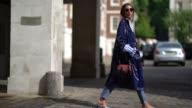 A guest wears a blue rain coat outside Simone Rocha during London Fashion Week September 2017 on September 16 2017 in London England