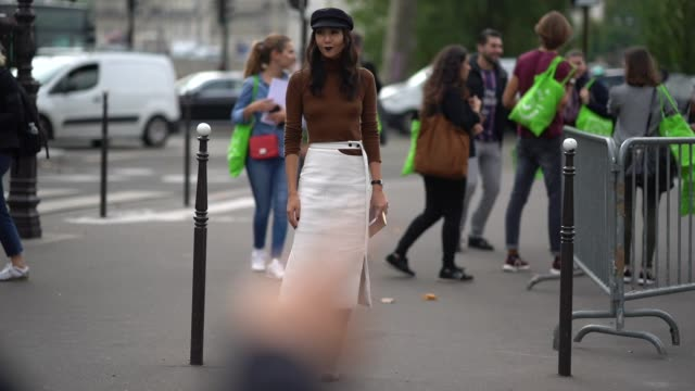 A guest wears a brown top a white skirt outside the Dries Van Noten show during Paris Fashion Week Womenswear Spring/Summer 2018 on September 27 2017...