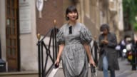 A guest wears a gray dress outside Simone Rocha during London Fashion Week September 2017 on September 16 2017 in London England