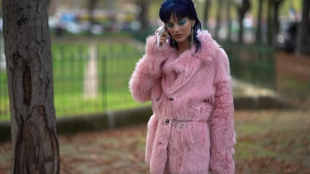 A guest wears a pink faux fur coat and a bag outside the Rochas show during Paris Fashion Week Womenswear Spring/Summer 2018 on September 27 2017 in...