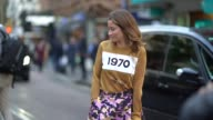 A guest wears a purple skirt a brown pull over '1970' outside House of Holland during London Fashion Week September 2017 on September 16 2017 in...