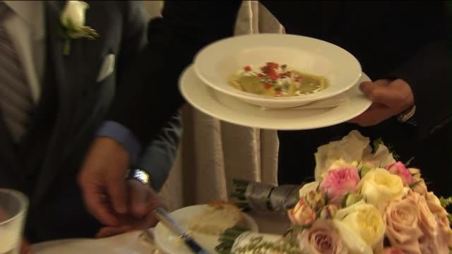 Guests Having Dinner at Wedding Reception