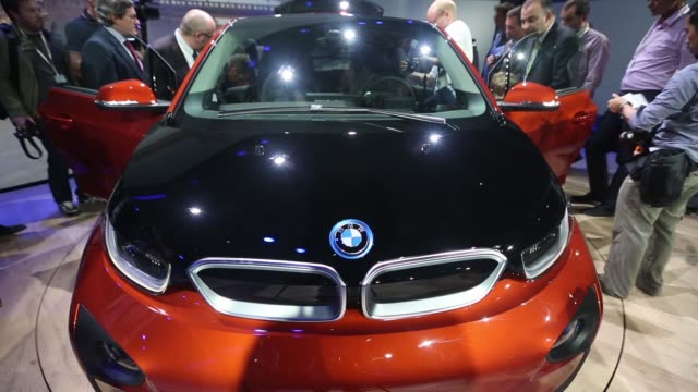 Guests try the interior cabin of the BMW i3 the electric automobile produced by Bayerische Motoren Werke AG during the world premiere launch in...
