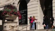 Guests visit the Art Institute of Chicago on September 17 2014 in Chicago Illinois The museum which draws around15 million visitors a year has been...
