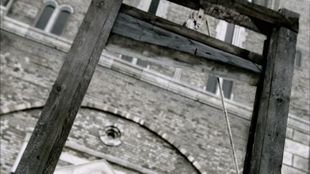 A guillotine falls.