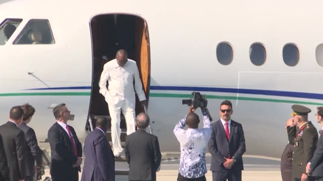 Guinean President Alpha Conde is welcomed by Turkish Parliament Speaker Ismail Kahraman upon his arrival at Ataturk Airport in Istanbul Turkey on...