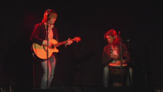 MS Guitar and bongo players performing on stage, London, England, UK