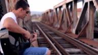 Guitar player on old bridge