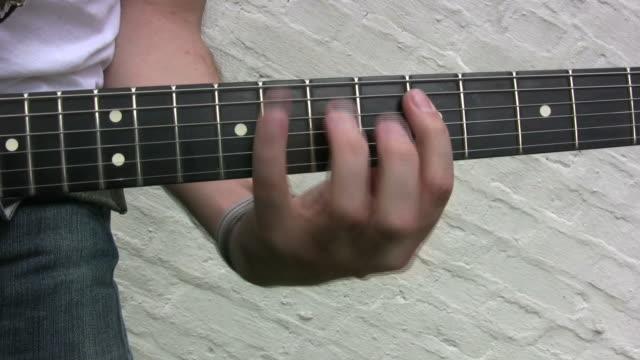 Guitar player, rock star, plain background (HD)