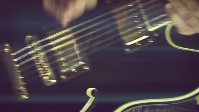 Guitarist Plugs in Guitar and Play