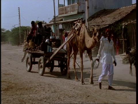 MS Gujarat, Indian family on cart, moving through street, Gujarat, India