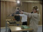 Gun control legislation ENGLAND Guns being fired at targets EXT man loading gun firing it at target