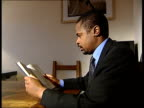 London Setup shots Tony Thompson reading book and interview SOT can get hold of pistol or sub machine gun in hours if you know right people