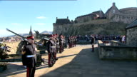 Edinburgh Edinburgh Castle EXT Guns on battlements / sign 'Mills Mount' / military band marching along SOT / crowd of onlookers / soldiers onto Mills...