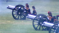 Gun Salute in Green Park Cannons being fired / ammunition being loaded / cannons firing / horses towards / soldiers pulling cannons away and...