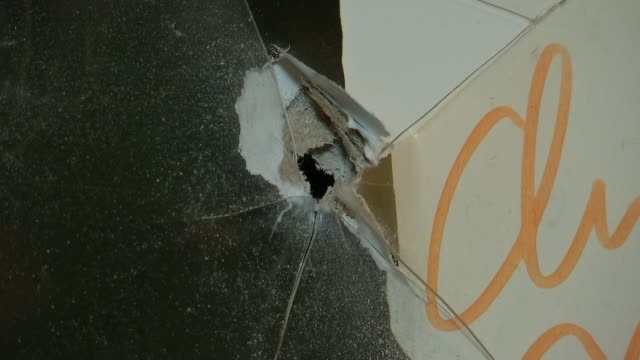 Gunman fires into home of Walthamstow couple Bullet hole in wall Close shot bullet hole Heather Gower interview SOT CUTAWAY broken picture frame...