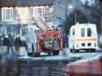 emergency services at scene of shooting ENGLAND Essex Ramsey EXT Fire Engines firemen police officers and 'The Castle' pub with exterior lights on...