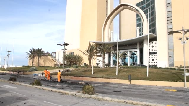 Gunmen stormed a luxury Tripoli hotel popular with diplomats and officials on Tuesday in an attack claimed by the Islamic State group killing at...