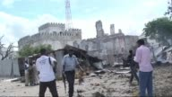 Gunmen wearing suicide vests stormed the main court complex in Mogadishu Sunday killing at least five people before holing themselves up as Somali...