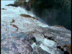 Gushing river flows over waterfall