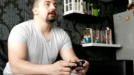 Guy playing video games on the couch at home