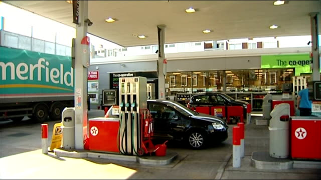 London EXT Low Angle shots of price sign at Texaco / Cooperative petrol station forecourt Somerfield van parked in forecourt PAN to petrol pumps...