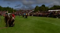 GVs Braemar Highland Games Man in kilt throwing weight / GVs crowd watching tug of war / Men competing in weight toss / GVs Military Parade with...