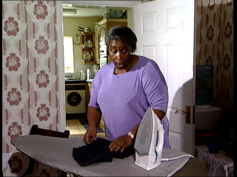 MINORITIES GVs Lucy Walters ironing as interviewed SOT Very hard work to start / problems encountered because adopted daughter had been cared for by...