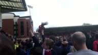 GVs of a Leyton Orient stadium announcer failing to get Orient fans off the pitch as they protest their club's relegation from the Football League