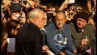 GVs of arrivals at European premiere of 'The Dark Knight' in London Michael Caine arriving and signing autographs for fans Aaron Eckhart arriving and...