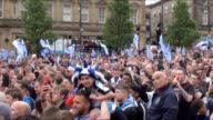GVs of Huddersfield Town victory parade following promotion to Premier League Includes crowd shots in St George's Squareflag being raised on top of...