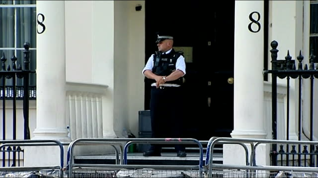 London Syrian Embassy EXT Syrian flag flying outside embassy / GV Embassy with police officer on duty / windows / barriers in front of embassy /...