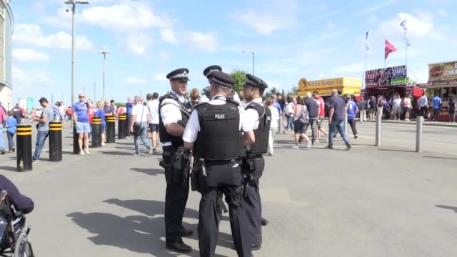 GVs of the heightened security around Wembley Stadium including armed police a helicopter and numerous police vehicles as Arsenal take on Chelsea in...