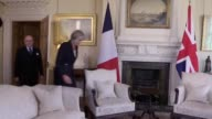 GVs of Theresa May greeting French Prime Minister Bernard Cazeneuve at 10 Downing Street GVs of the two exchanging warm words