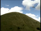 GVs Silbury Hill as helicopter at top delivering bags of chalk for repairs AIR VIEWS Bags of chalk on top of hill