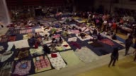 A gym in Mexico City has been set up to act as one of the shelters for people that have lost or cannot enter their homes after the devastating and...