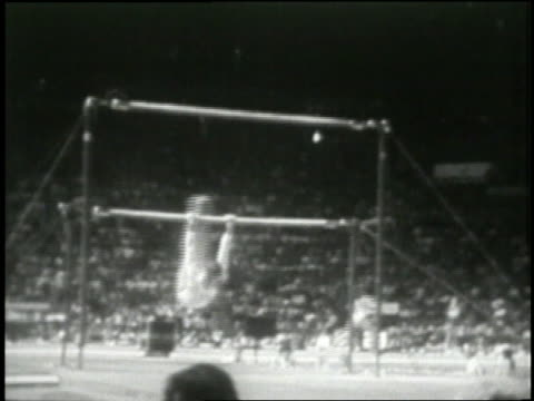 Gymnast Nadia Comaneci completes a routine on the uneven bars scoring a perfect 10