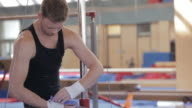MS Gymnast wrapping wrists for gymnastic exercise / Vancouver, British Columbia, Canada