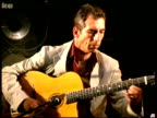 Gypsy jazz guitarist Angelo DeBarre performing, France
