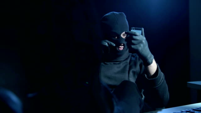Hacker with smartphone