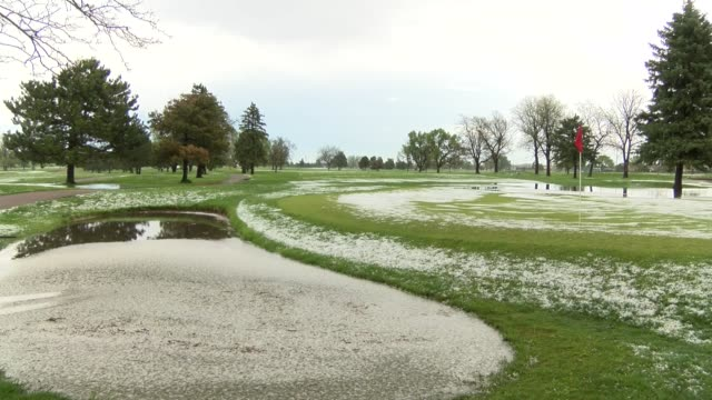 A hail storm roared through the Denver metro area leaving flooding of Park Hill golf course with water and coats of white ice