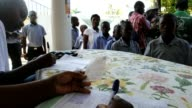 Haitians receive the second dose of the vaccine against cholera as part of the UN's vaccination campaign