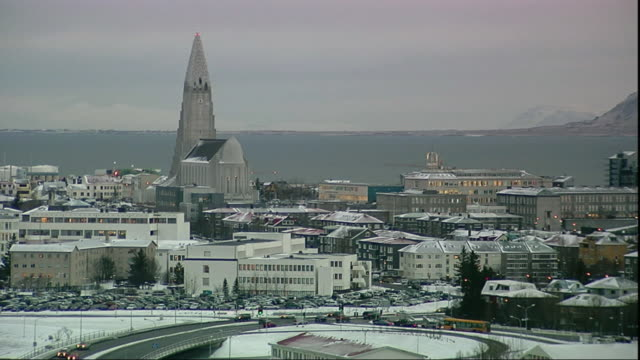 WS PAN Hallgrimskirkja church toward bay and Esja mountain at dusk / Reykjavik, Iceland